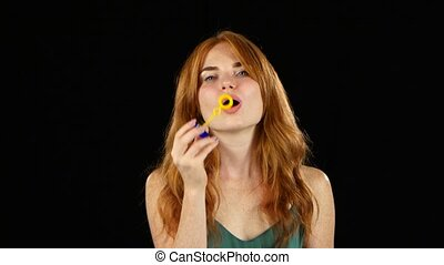 Girl lets the soap bubbles. Black background - Girl lets...