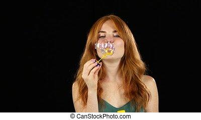 Girl lets the soap bubbles. Black background - Girl lets...