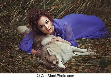 Girl lies on a dead dog.
