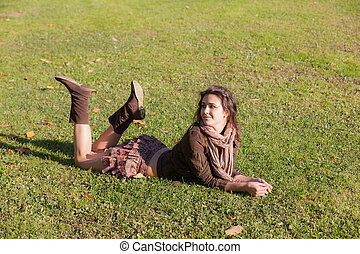 girl lies on a lawn