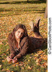 girl lies on grass