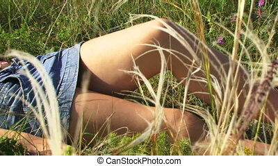 Girl lies on the field
