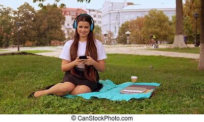 girl listen song resting outdoors