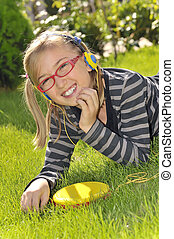 girl listening music in the park