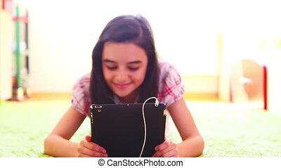 Girl listening music on tablet pc