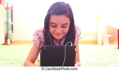 Girl listening music on tablet pc
