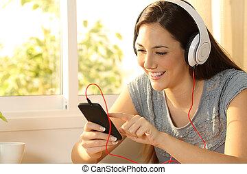 Girl listening music selecting song