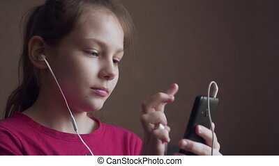 Girl listening to music from earings and feeling rhythm.