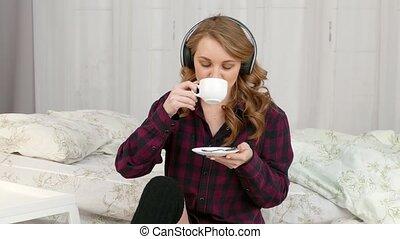 Girl listening to music on headphones - A beautiful girl...
