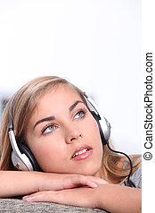 Girl listening to music on headphones
