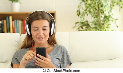 Girl listening to music selecting song