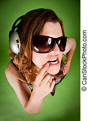 Girl listening to music wear sunglasses