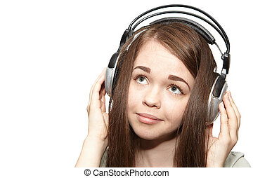 Girl listening to the music on a white background
