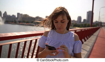 girl listens to music from the phone