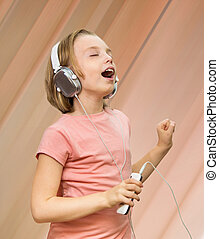 Girl listens to music.
