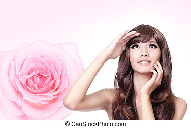 Girl look up forward with smile and pink rose