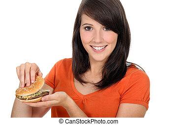 girl looking at a hamburger