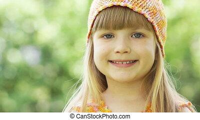 Girl looking at camera and talking