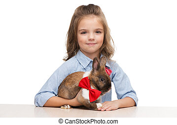 Girl looking at camera with bunny