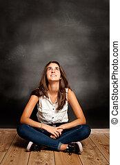 girl looking at chalkboard - pensive girl looking at...