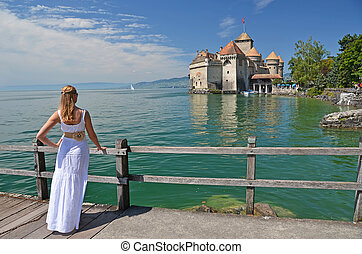Girl looking at Chillion castle. Geneva lake, Switzerland