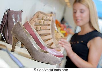 girl looking at foorwear