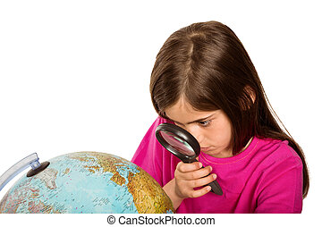Girl looking at globe through glass - Cute pupil looking at...