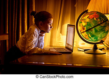 Girl looking at laptop screen