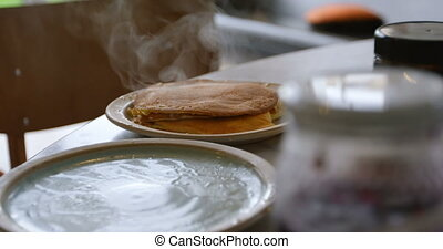 Girl looking at pancakes on dining table 4k - Side view of ...