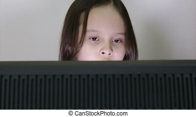 Girl looking at PC screen