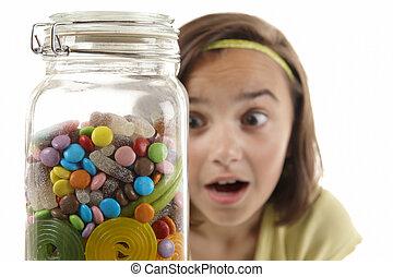 girl looking at sweet jar