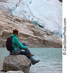 girl looking at the glacier