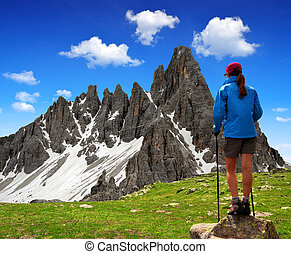 Girl looking at the Paternkofel , Dolomite Alps, Italy