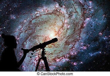 Girl looking at the stars with telescope. Messier 83, Southern Pinwheel Galaxy, M83 in the constellation Hydra. Elements of this image are furnished by NASA.