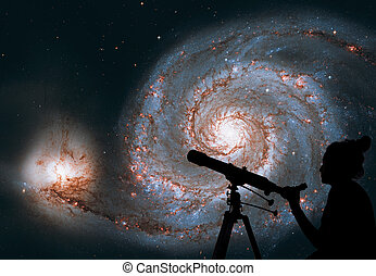 Girl looking at the stars with telescope. Whirlpool Galaxy. Spiral galaxy M51 or NGC 5194 Elements of this image are furnished by NASA.