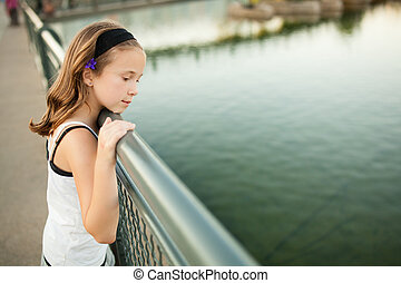 Girl looking at water