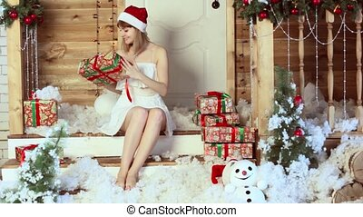 girl looking Christmas gifts