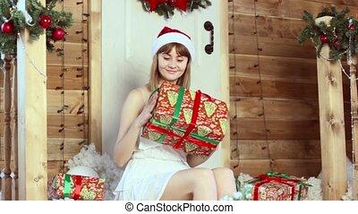 girl looking Christmas gifts