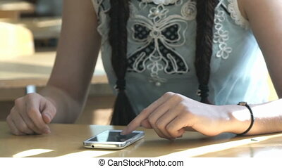 Girl looking for information using the smartphone