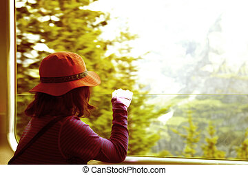 Girl looking from a train window