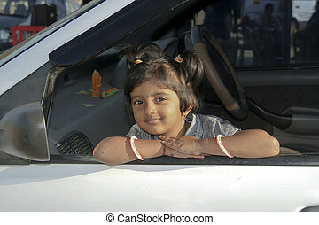 Girl looking from Car Window