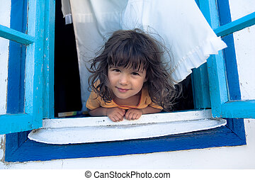 Girl looking from window
