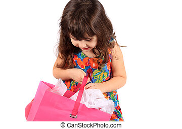 Girl looking in gift bag - Cute little three year old girl ...