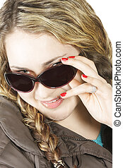 Girl looking over sunglasses
