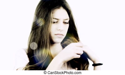 Girl looking split ends hair - Beautiful girl with very long...