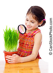 Girl looking through a magnifying glass - Girl looking at...