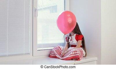 Girl  looking through the window bored.