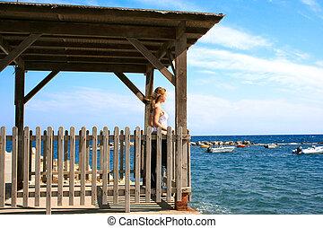 Girl looking to sea