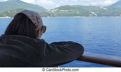 Girl Looking to Shoreline by Ship - Tourist girl looking to...