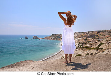 Girl looking to the Aphrodite birthplace, Cyprus